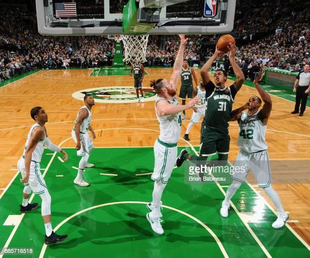 John Henson of the Milwaukee Bucks goes to the basket against the Boston Celtics on December 4 2017 at the TD Garden in Boston Massachusetts NOTE TO...