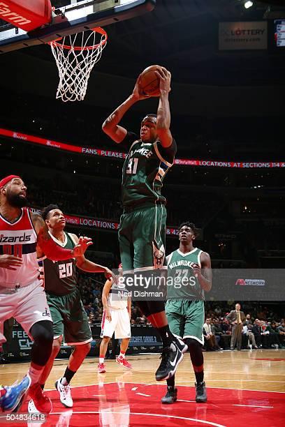 John Henson of the Milwaukee Bucks grabs the rebound against the Washington Wizards on January 13 2016 at Verizon Center in Washington DC NOTE TO...