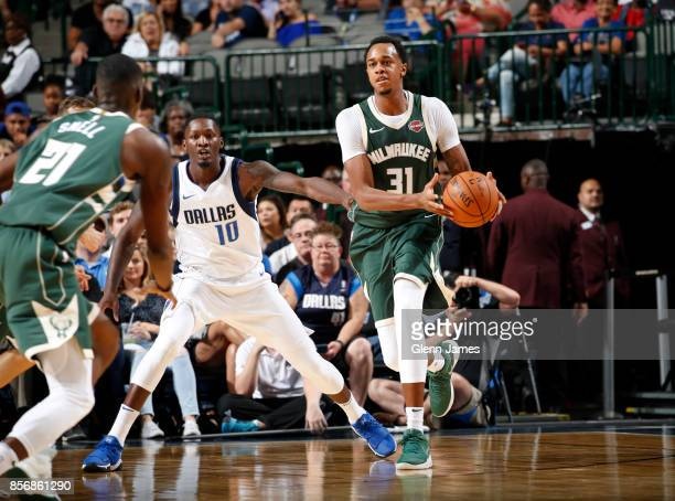 John Henson of the Milwaukee Bucks handles the ball against Dorian FinneySmith of the Dallas Mavericks during the preseason game on October 2 2017 at...