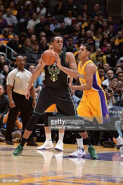 John Henson of the Milwaukee Bucks handles the ball against Jordan Clarkson of the Los Angeles Lakers on December 15 2015 at STAPLES Center in Los...