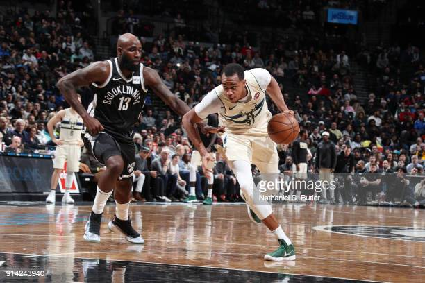 John Henson of the Milwaukee Bucks handles the ball against Quincy Acy of the Brooklyn Nets on February 4 2018 at Barclays Center in Brooklyn New...