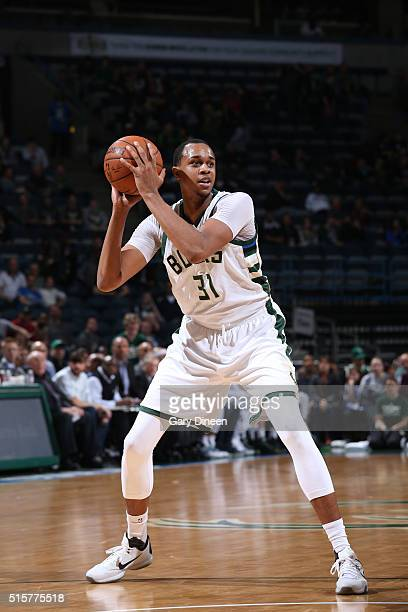 John Henson of the Milwaukee Bucks handles the ball against the Toronto Raptors on March 15 2016 at the BMO Harris Bradley Center in Milwaukee...