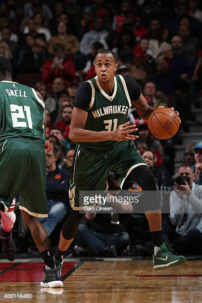 John Henson of the Milwaukee Bucks handles the ball against the Chicago Bulls on December 16 2016 at the United Center in Chicago Illinois NOTE TO...