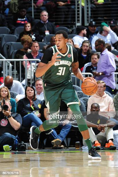 John Henson of the Milwaukee Bucks handles the ball against the Atlanta Hawks on October 29 2017 at Philips Arena in Atlanta Georgia NOTE TO USER...