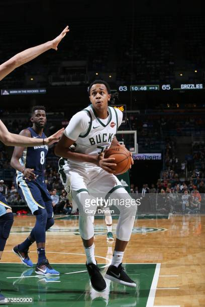 John Henson of the Milwaukee Bucks handles the ball against the Memphis Grizzlies on November 13 2017 at the BMO Harris Bradley Center in Milwaukee...