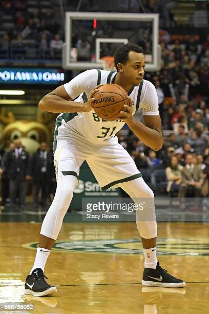 John Henson of the Milwaukee Bucks handles the ball during a game against the Sacramento Kings at the Bradley Center on December 2 2017 in Milwaukee...