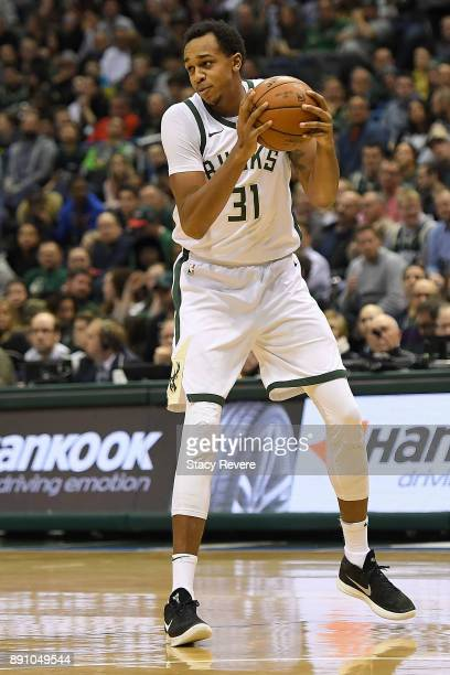 John Henson of the Milwaukee Bucks handles the ball during a game against the Utah Jazz at the Bradley Center on December 9 2017 in Milwaukee...