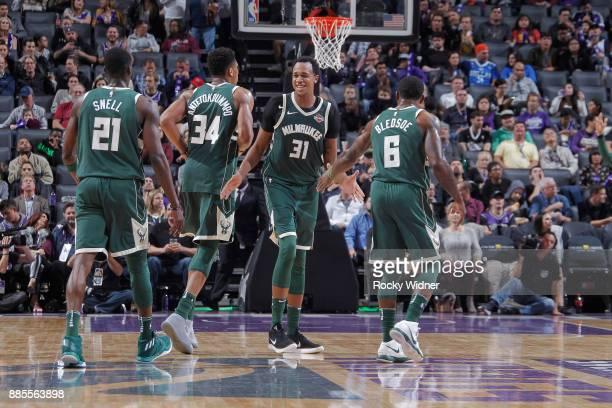 John Henson of the Milwaukee Bucks high fives teammates against the Sacramento Kings on November 28 2017 at Golden 1 Center in Sacramento California...