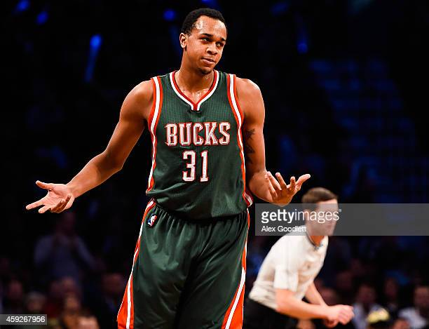 John Henson of the Milwaukee Bucks reacts after a turnover in the fourth quarter during a game against the Brooklyn Nets at the Barclays Center on...