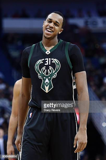 John Henson of the Milwaukee Bucks reacts to an officials call during the first half of a game against the New Orleans Pelicans at the Smoothie King...