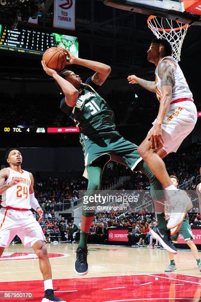 John Henson of the Milwaukee Bucks shoots the ball against the Atlanta Hawks on October 29 2017 at Philips Arena in Atlanta Georgia NOTE TO USER User...