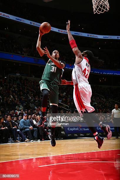 John Henson of the Milwaukee Bucks shoots the ball against the Washington Wizards on January 13 2016 at Verizon Center in Washington DC NOTE TO USER...