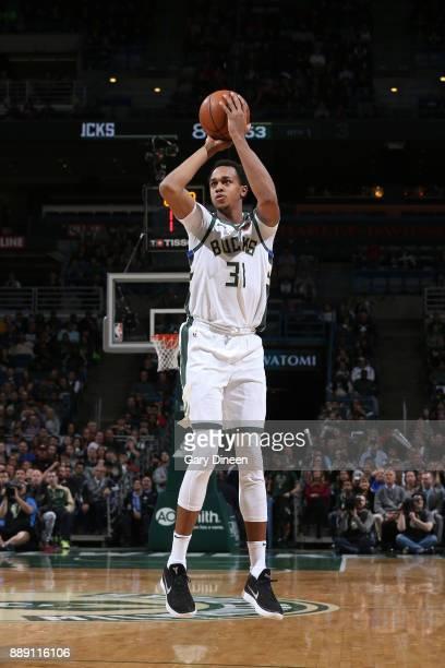 John Henson of the Milwaukee Bucks shoots the ball against the Utah Jazz on December 9 2017 at the BMO Harris Bradley Center in Milwaukee Wisconsin...