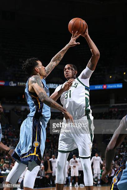 John Henson of the Milwaukee Bucks shoots the ball during the game against the Memphis Grizzlies on March 17 2016 at the BMO Harris Bradley Center in...