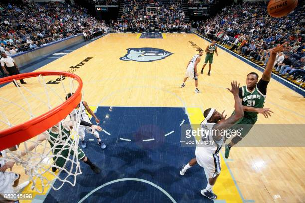 John Henson of the Milwaukee Bucks shoots the ball during the game against the Memphis Grizzlies on March 13 2017 at FedExForum in Memphis Tennessee...