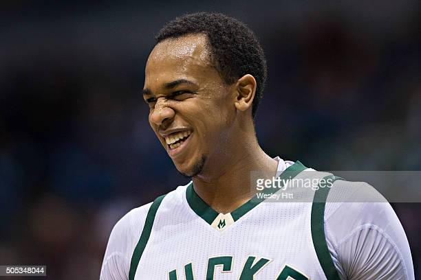 John Henson of the Milwaukee Bucks smiles on the court during a game against the San Antonio Spurs at BMO Harris Bradley Center on January 4 2016 in...