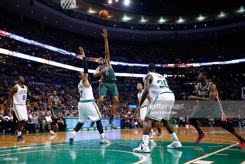 John Henson #31 of the Milwaukee Bucks takes a shot over Jared Sullinger #7 of the Boston Celtics in the second half during the game at TD Garden on December 3, 2013 in Boston, Massachusetts.