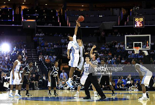 John Henson of the North Carolina Tar Heels and Julian Boyd of the Long Island Blackbirds go after the opening jump during the second round of the...
