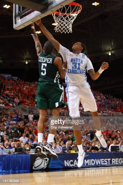 John Henson of the North Carolina Tar Heels blocks a shot attempt n the second half by DJ Cooper of the Ohio Bobcats during the 2012 NCAA Men's...