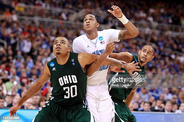 John Henson of the North Carolina Tar Heels fights for rebound position in the second half against Reggie Keely and Walter Offutt of the Ohio Bobcats...