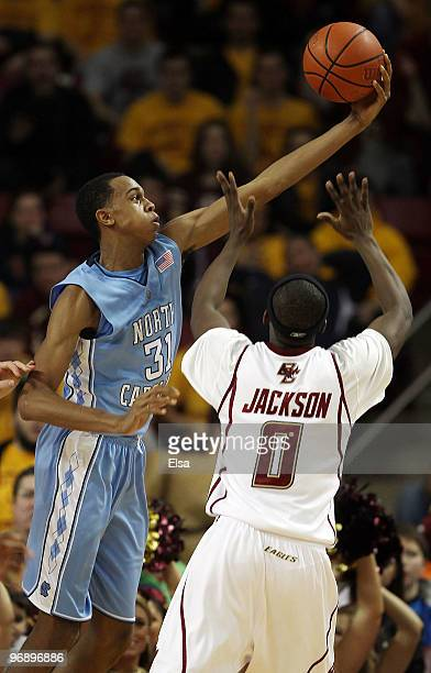 John Henson of the North Carolina Tar Heels grabs the ball as Reggie Jackson of the Boston College Eagles defends on February 20 2010 at Conte Forum...
