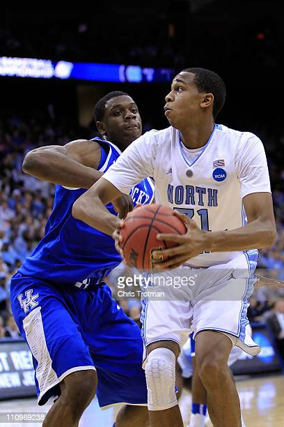 John Henson of the North Carolina Tar Heels in action against Terrence Jones of the Kentucky Wildcats during the east regional final of the 2011 NCAA...