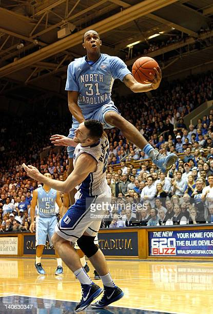 John Henson of the North Carolina Tar Heels jumps over Miles Plumlee of the Duke Blue Devils as he drives to the basket during their game at Cameron...