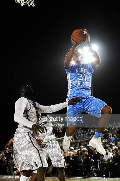 John Henson of the North Carolina Tar Heels makes a move to the basket against Draymond Green of the Michigan State Spartans in the first half during...