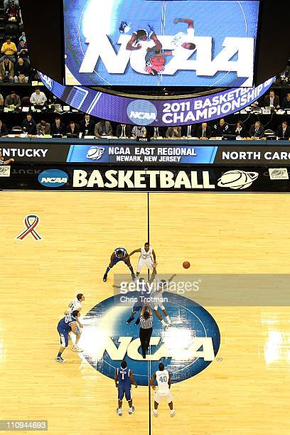John Henson of the North Carolina Tar Heels tips off against Terrence Jones of the Kentucky Wildcats to start the east regional final of the 2011...