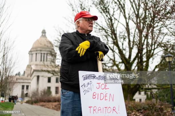 John Hess, a Donald Trump supporter, holds a sign while protesting at the Washington State Capitol on January 20, 2021 in Olympia, United States. One...