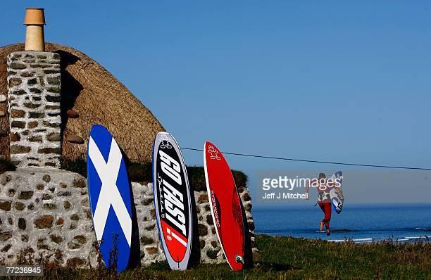 John Hibbard, the only British competitor in the Corona Extra PWA World Cup, runs towards Balevullin beach on the Hebridean island of Tiree on...