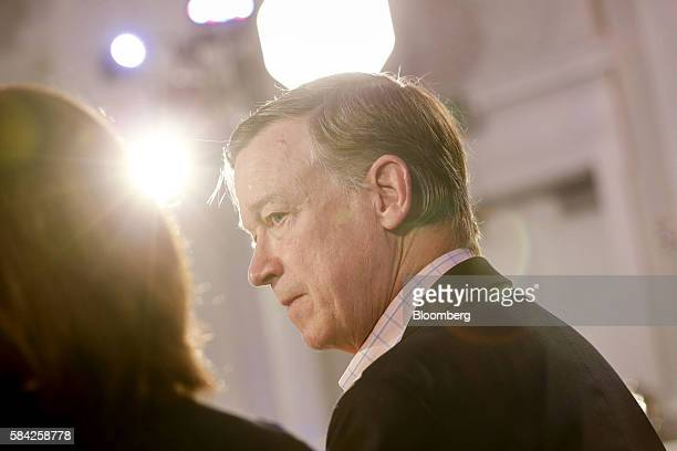 John Hickenlooper governor of Colorado listens during a Bloomberg Politics interview on the sidelines of the Democratic National Convention in...