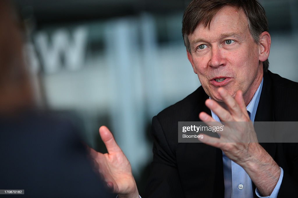 John Hickenlooper, governor of Colorado, speaks during an interview in Washington, D.C., U.S., on Wednesday, June 19, 2013. 'Were going to regulate the living daylights out of it,' Hickenlooper said speaking about marijuana regulation. Photographer: Julia Schmalz/Bloomberg via Getty Images