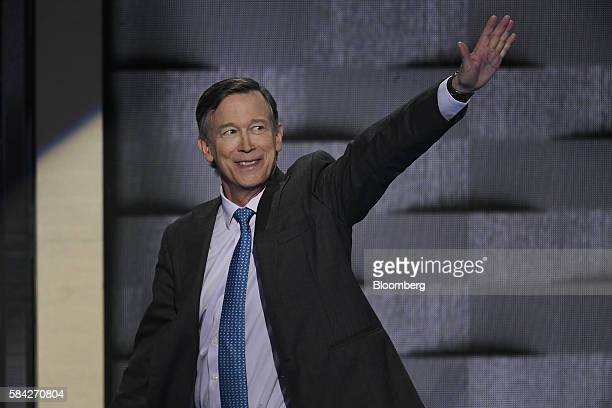 John Hickenlooper governor of Colorado waves while arriving on stage during the Democratic National Convention in Philadelphia Pennsylvania US on...