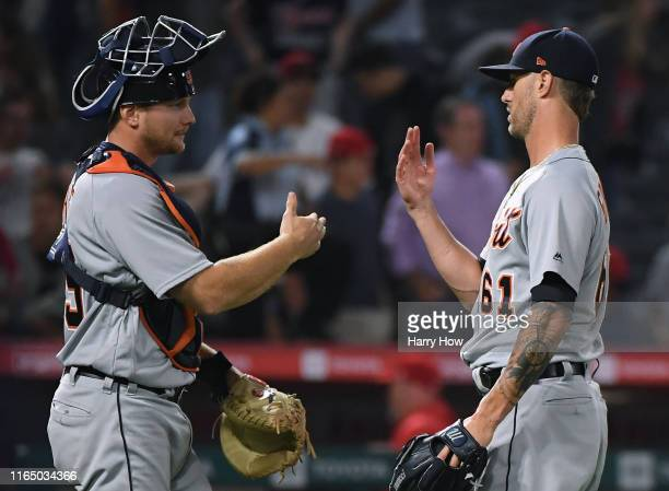John Hicks and Shane Greene of the Detroit Tigers celebrate a 72 win over the Los Angeles Angels at Angel Stadium of Anaheim on July 29 2019 in...