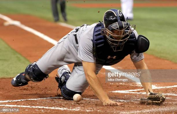 John Hicks of the Detroit Tigers drops the ball allowing Carlos Gomez of the Tampa Bay Rays to score during a game at Tropicana Field on July 10 2018...