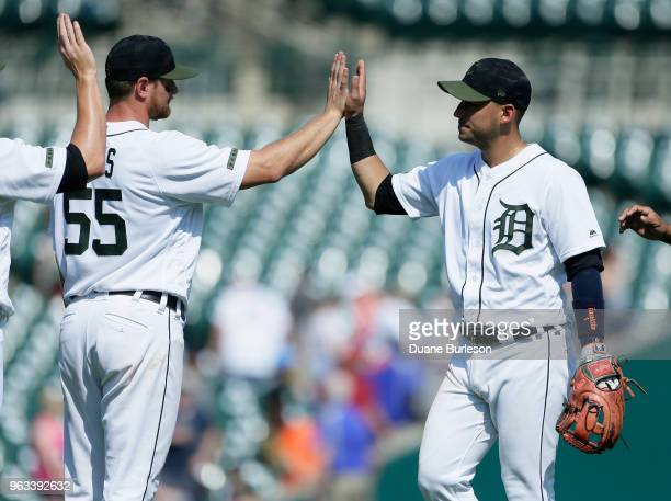 John Hicks of the Detroit Tigers nd Jose Iglesias of the Detroit Tigers celebrate a 93 win over the Los Angeles Angels at Comerica Park on May 28...