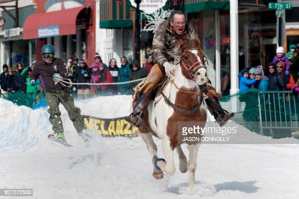 John Hide races down Harrison Avenue on his horse Hidalgo while pulling a skier during the 70th annual Leadville Ski Joring weekend competition on...