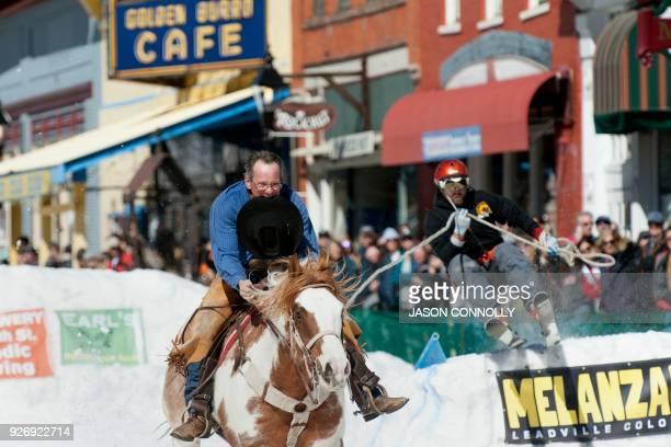 John Hide races down Harrison Avenue on his horse Hidalgo while pulling skier Craig Kaopasz during the 70th annual Leadville Ski Joring weekend...