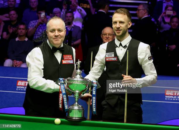 John Higgins and Judd Trump pose for pictures ahead of the Final of the World Snooker Championship match between Judd Trump and John Higgins at the...