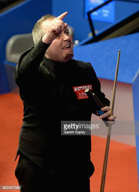 John Higgins celebrates beating Ryan Day during their first round match of the World Snooker Championship at Crucible Theatre on April 19 2016 in...
