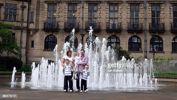 John Higgins celebrates with the Betfred Worlld Championship Trophy with wife Denise and children Claudia Oliver and Pierce after winning the Final...