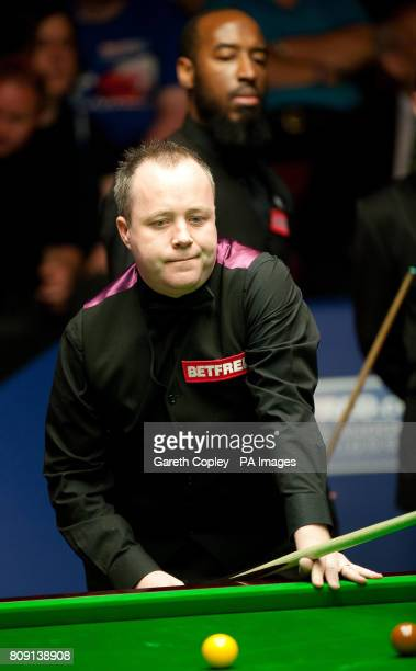 John Higgins in action against Rory McLeod during their second round match of the Betfredcom World Snooker Championships at the Crucible Sheffield