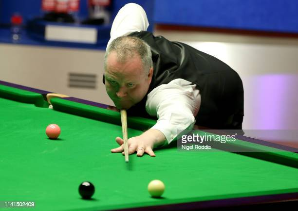 John Higgins in action during the Final of the World Snooker Championship match between Judd Trump and John Higgins at the Crucible Theatre on May 5,...