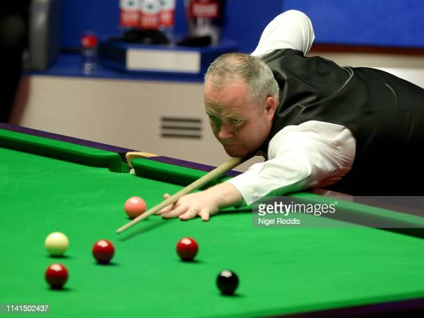 John Higgins in action during the Final of the World Snooker Championship match between Judd Trump and John Higgins at the Crucible Theatre on May 5...