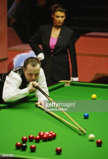 John Higgins is watched by match referee Michaela Tabb during his Embassy World Snooker match against Ryan Day at The Crucible Theatre on April 18...