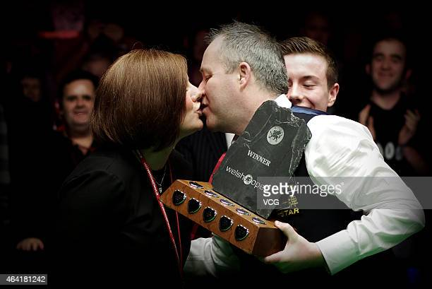 John Higgins kisses his wife Denise Higgins after winning the final match during day seven of 2015 BetVictor Welsh Open at Motorpoint Arena on...