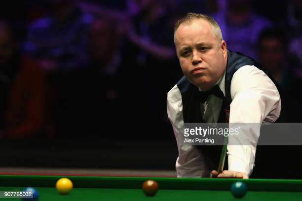 John Higgins looks dejected during the SemiFinal match between Mark Allen and John Higgins on Day Seven of The Dafabet Masters at Alexandra Palace on...