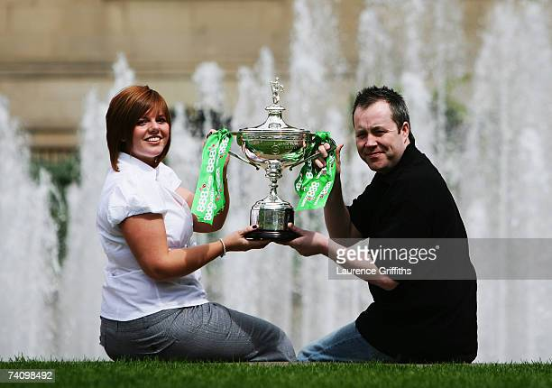 John Higgins of Scotland and wife Denise celebrate with the 888com World Championship Trophy after his victory over Mark Selby of England at The...