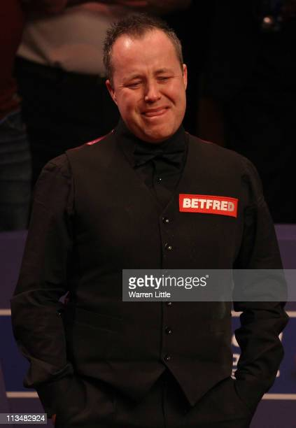 John Higgins of Scotland breaks down in tears after beating Judd Trump of England to win the Betfredcom World Snooker Championship at the Crucible...
